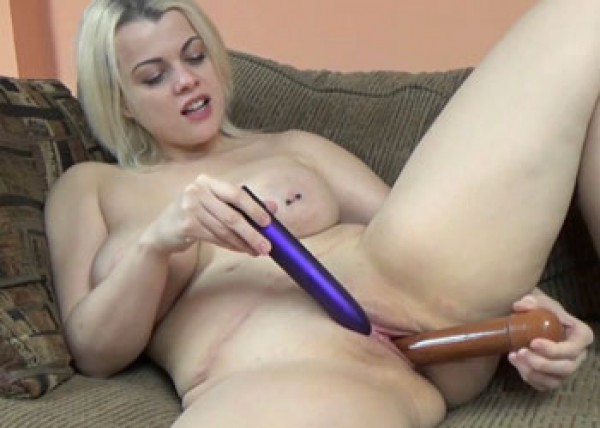 Nadia White is playing with two toys