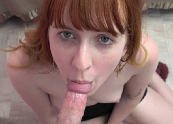 Hannah's on her knees to give a blowjob